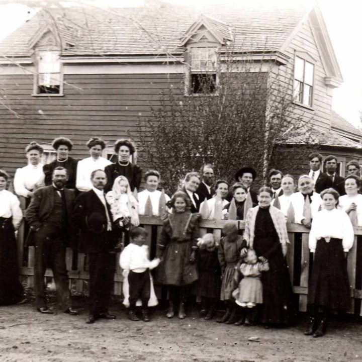 Ancestors in front of old house